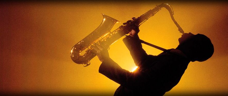 awesome-jazz-music-saxophonist-silhouette-web-header